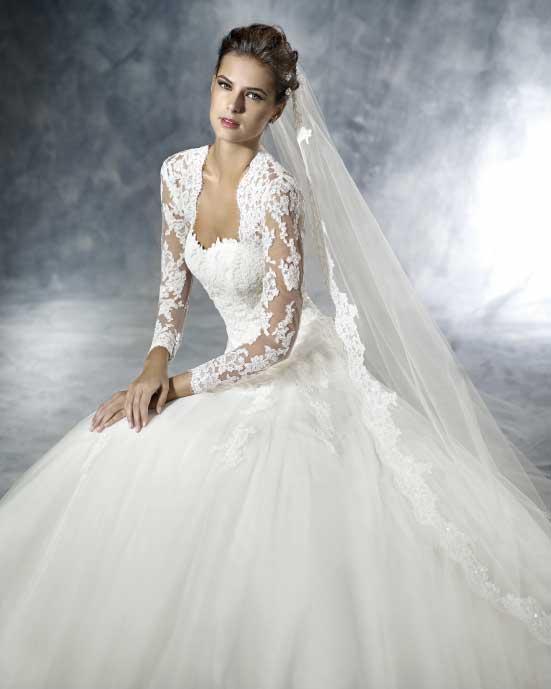 Koronkowe bolerko z długim rękawem do sukni ślubnej